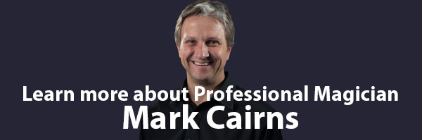 Learn more about magician Mark Cairns button image